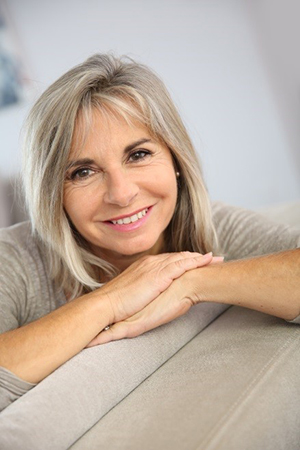 An older woman calmly smiling